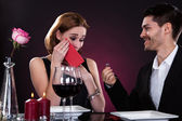 Portrait of couple in restaurant — Stock Photo
