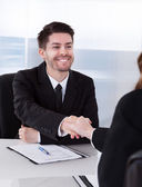 Two businesspeople shaking hand — Stock Photo