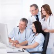 Group Of Doctors Working Together — Stock Photo #27663999