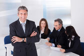 Businessman Standing In Front Of Colleagues — Stock Photo