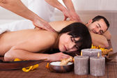 Beautiful Young Couple Enjoying Massage — Stock Photo