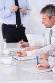 Businesspeople Writing Notes In Meeting — Stock Photo