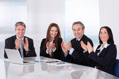 Happy Businesspeople Clapping — Stock Photo