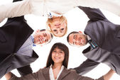 Group Of Businesspeople Putting Heads Together — Stock Photo