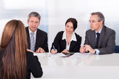 Businesspeople Interviewing Woman — Stock Photo