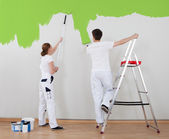 Young Couple Painting Wall — Stock Photo