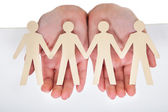 Male Hand Holding Human Figure Cutout — Stock Photo