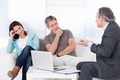 Mature Consultant Explaining To Couple — Stock Photo