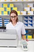 Female Pharmacist In Pharmacy — Stock Photo