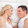 Couple On Bed Looking At Each other — Stock Photo #28062591