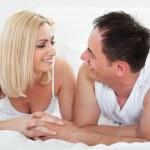 Happy Couple Lying On Bed — Stock Photo
