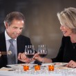 Mature Couple Sitting In A Restaurant — Stock Photo