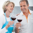 Happy Mature Drinking Wine In Kitchen — Stock Photo