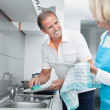 Mature Couple Cleaning Utensils — Stock Photo