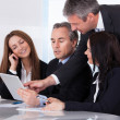 Businesspeople Using Digital Tablet — Stockfoto