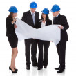 Group Of Architects Discussing Blueprint — Stock Photo