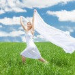 Woman Holding Scarf Running In Field — Stock Photo