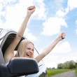 Woman Raising Hand Out Of Car Window — Stock Photo