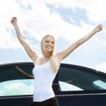 Woman Standing Near Car Raising Her Hand — Stock Photo