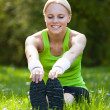 Young Happy Blonde Woman Stretching Leg — Stock Photo