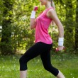 Stock Photo: Young Woman Exercising With Dumbbells