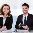 Portrait of two happy business colleagues at office — Foto Stock