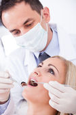 Dentist Examining Patient — Stockfoto