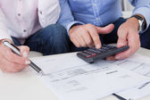 Close-up of couple doing finances at home — Stock Photo