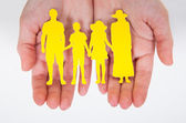 Male Hand Holding Family Cutout Shape — Stock Photo