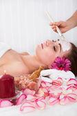 Woman getting facial mask at spa studio — Stock Photo