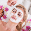 Stockfoto: Cosmetician Applying Facial Mask On Face Of Woman