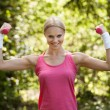 Young Woman Exercising With Dumbbells — Stock Photo #28607989