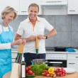 Mature Couple Cooking In Kitchen — Stock fotografie #28608233