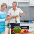 Stock Photo: Mature Couple Cooking In Kitchen