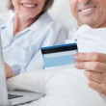 Happy Couple Shopping Online — Stock Photo #28608267