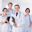 Stock Photo: Male Doctor In Front Of Team