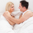 Lovers Embracing Each Other In Bed — Stock Photo #28608585