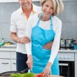 Couple Preparing Food In Kitchen — Stock Photo
