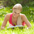 Young Beautiful Woman Lying On Grass Writing In Diary — Stock Photo