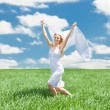 Woman Holding Scarf Running In Field — ストック写真