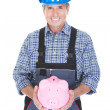Portrait Of A Worker Holding Piggybank — Stock Photo #28608867