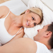 Couple On Bed Looking At Each other — Stock Photo #28608925