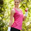 Young Woman Exercising With Dumbbells — Stock Photo #28609087