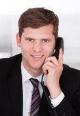 Businessman talking on telephone — Stock Photo
