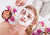 Cosmetician Applying Facial Mask On Face Of Woman — Foto de Stock