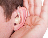 Man Wearing Hearing Aid And Listening For A Quiet Sound — Stock Photo