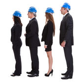 Group Of Happy Architects Standing In A Row — Stock Photo