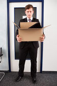 Man holding cardboard — Stock Photo
