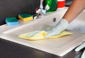 Woman Cleaning Worktop — Stock Photo