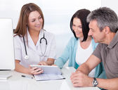 Doctor Showing Digital Tablet To Patient — Stock Photo